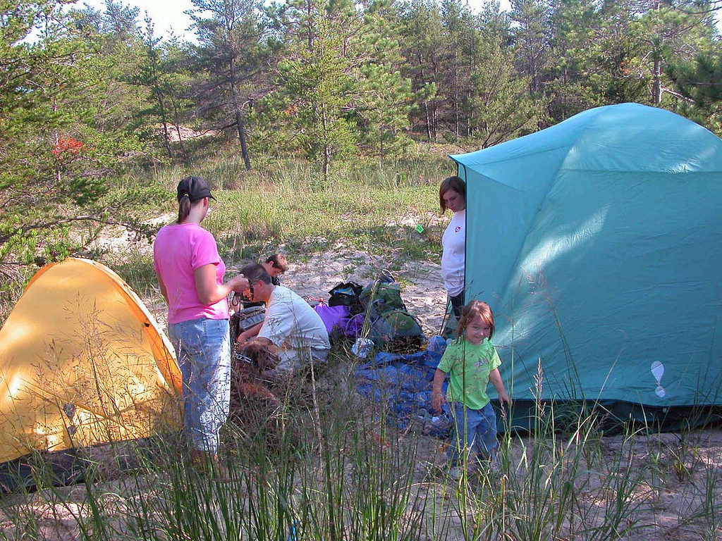 People-standing-around-camping-tents